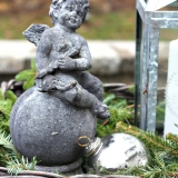 Cherub-with-silver-ornament-and-lantern