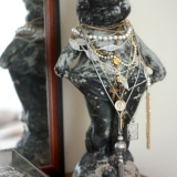 Outdoor-statue-holding-jewelry