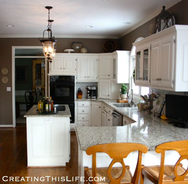 how to decorate space above kitchen cabinets that space above the cabinets creating this 9374