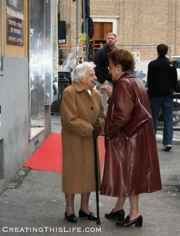 Ladies meeting on the street in Rome