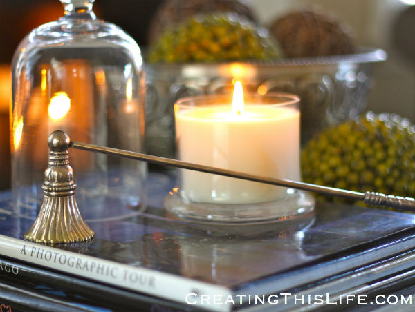 Silver candle snuffer with bell jar candle