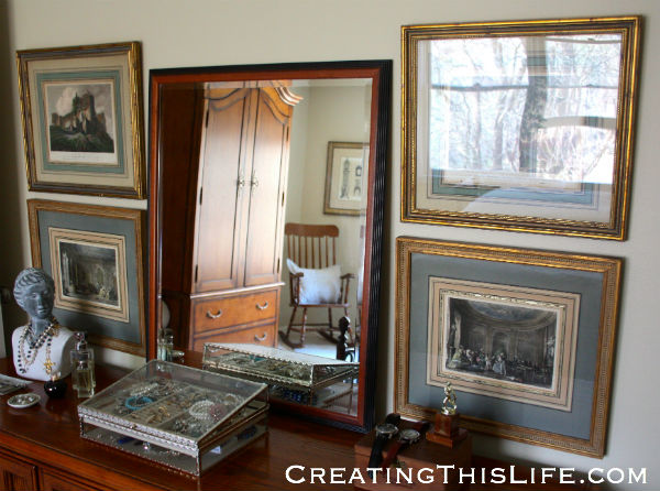 Secondhand vintage framed prints over dresser