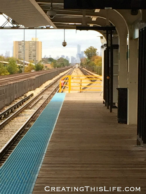 Train platform in Oak Park IL with Chicago skyline in the distance