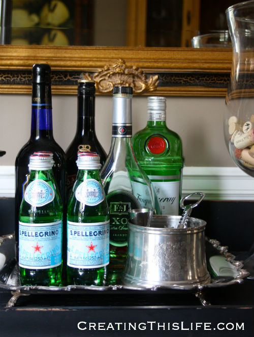 Vintage silver tray holding liquor