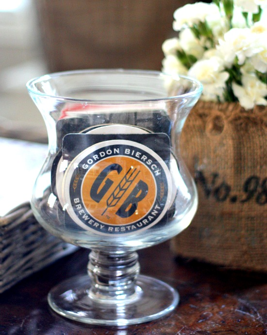 paper coasters in clear vase